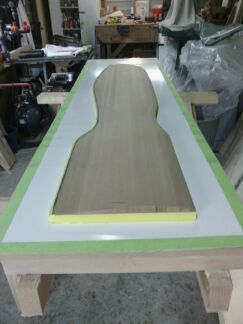 Half the rudder core blank on vac table, ready for primer brew and laminate